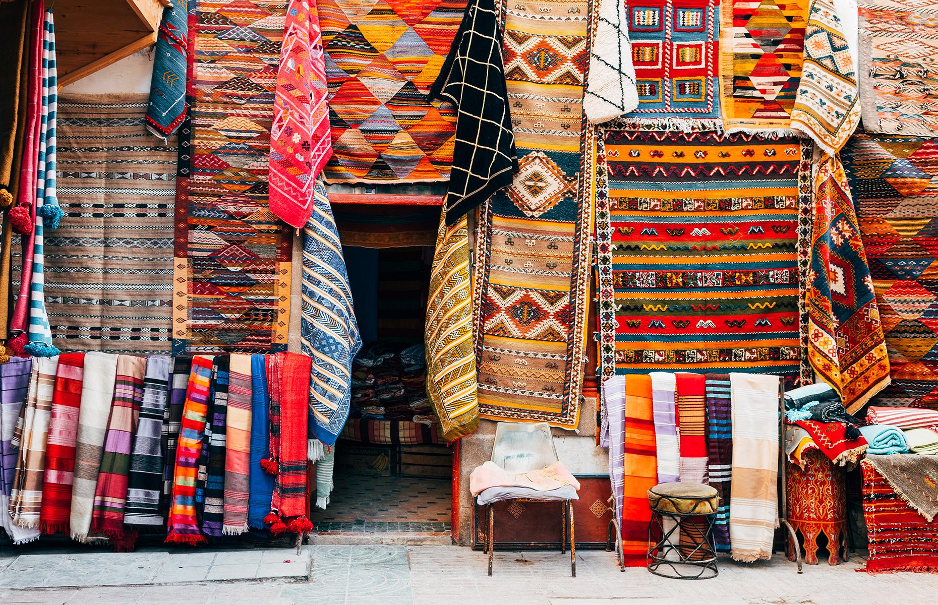Carpets in a souk in Marrakech (Image: jon Chica/Shutterstock)