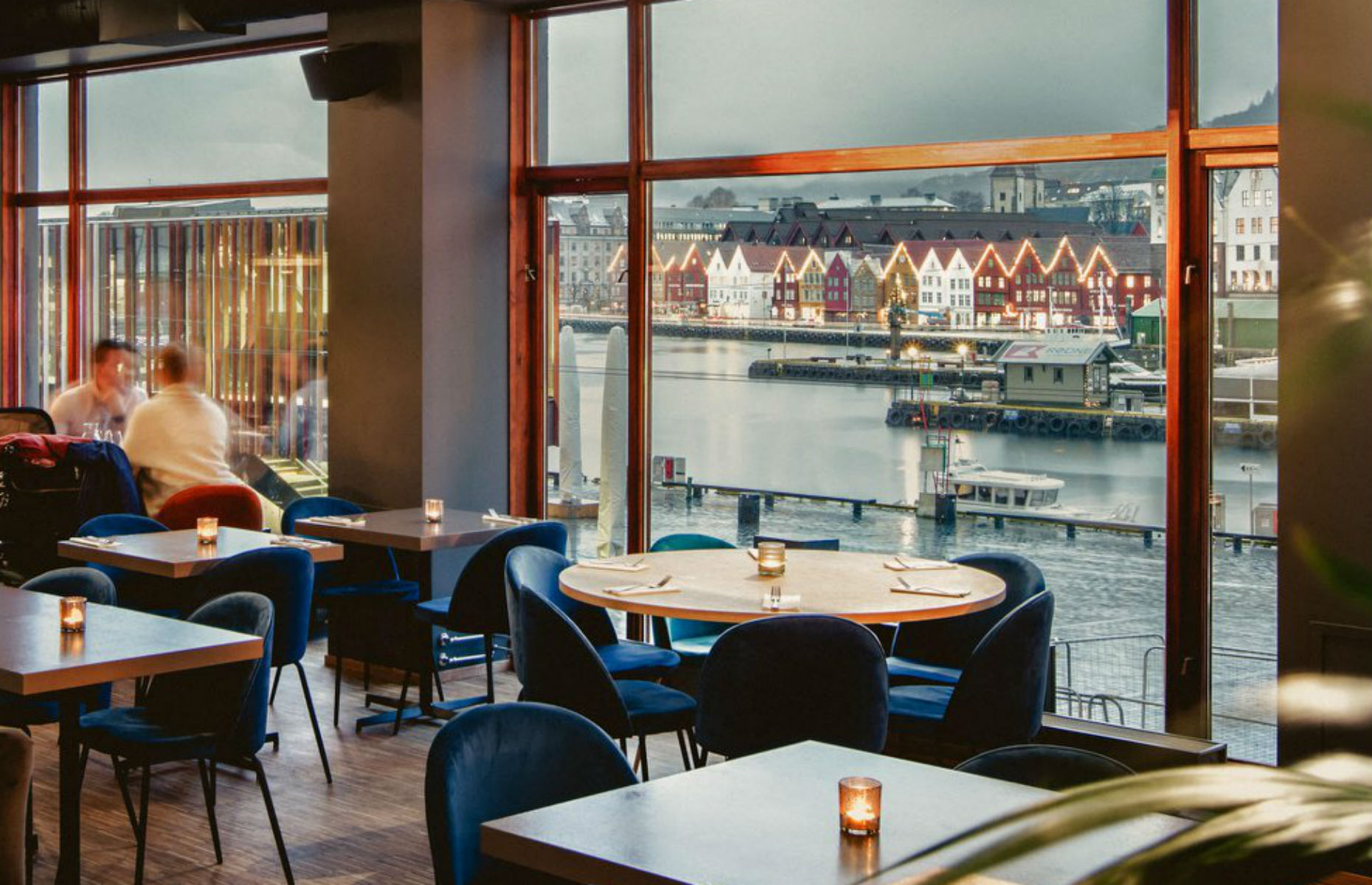 A table at Bjerck restaurant and bar with a view of the harbour (Image: Bjerck Restaurant & Bar/Facebook)