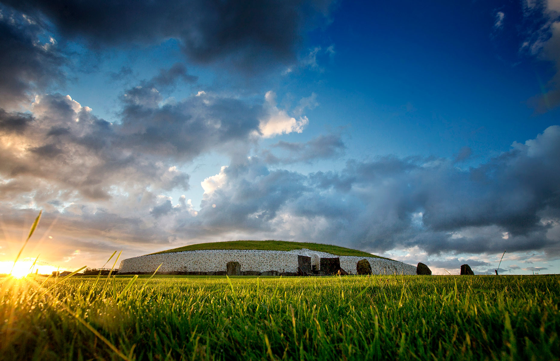 Newgrange monument is a tomb in the Boyne Valley, Ireland, pictured here at sunset