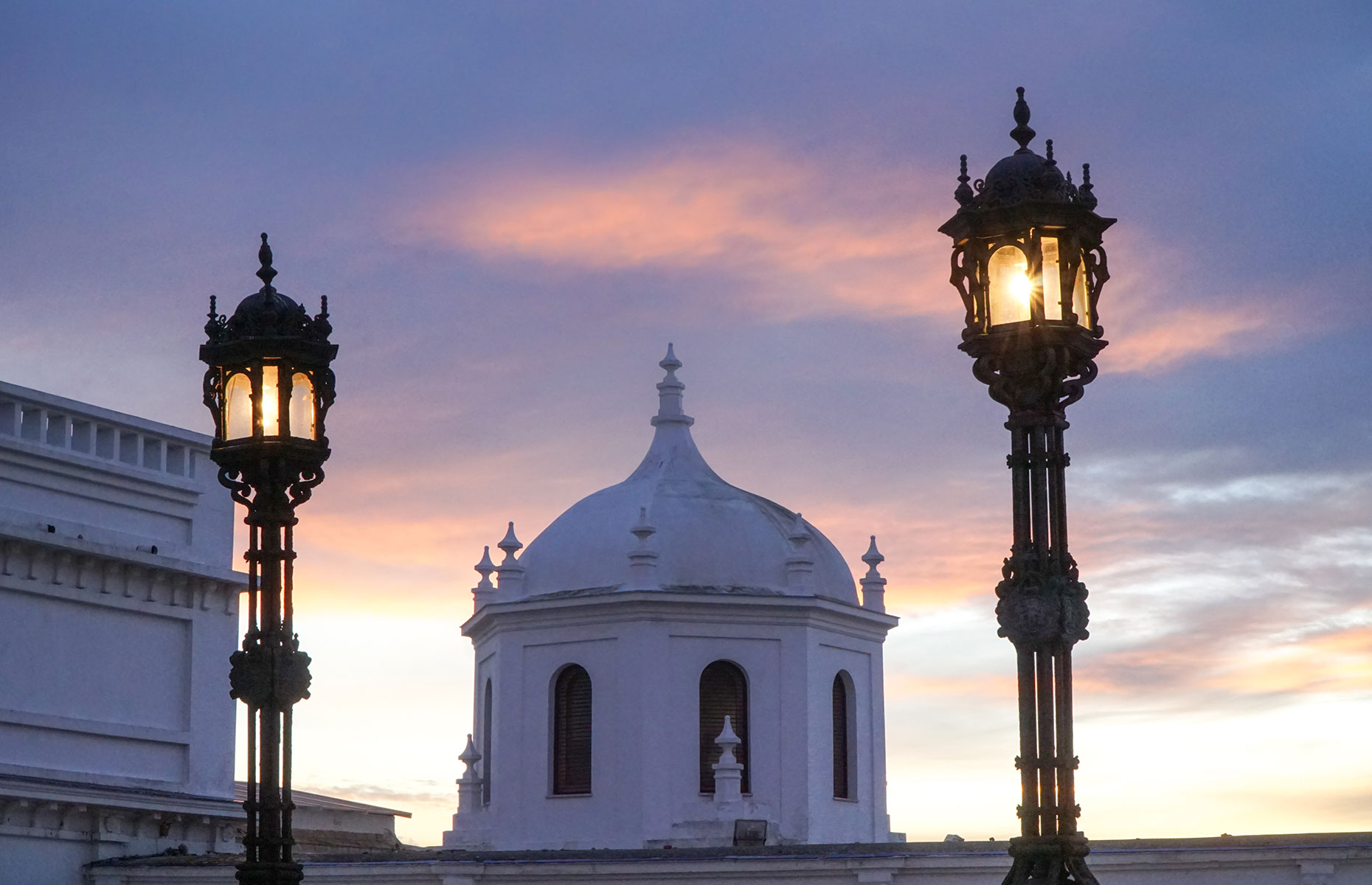 Dome building in Cadiz, Spain with sunset skyline