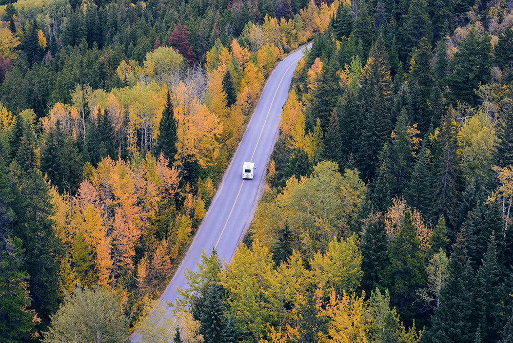 Motorhome driving through fall foliage