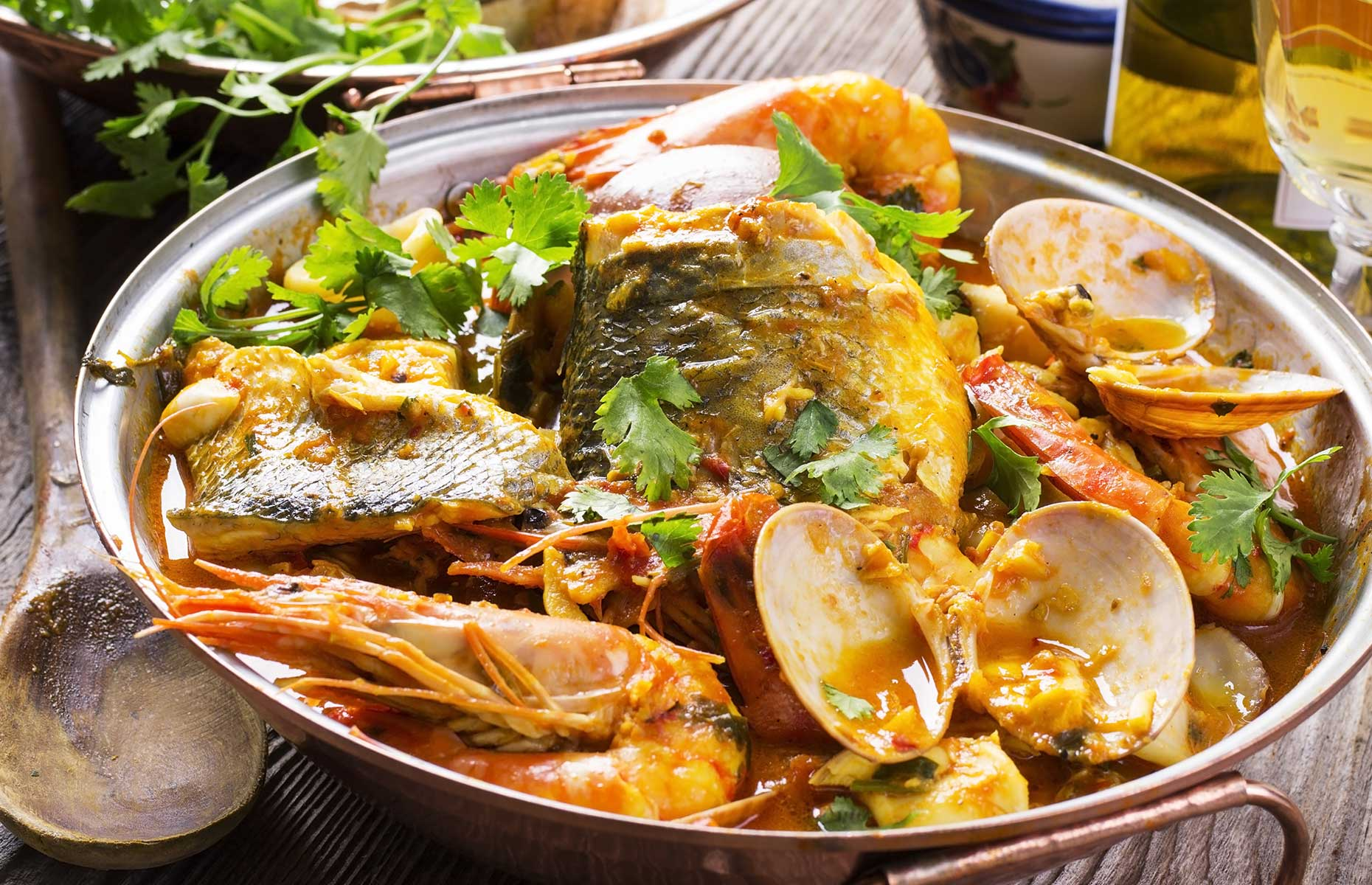 Cataplanas (pork and seafood) is a typically Algarvian dish (Image: hlphoto/Shutterstock)