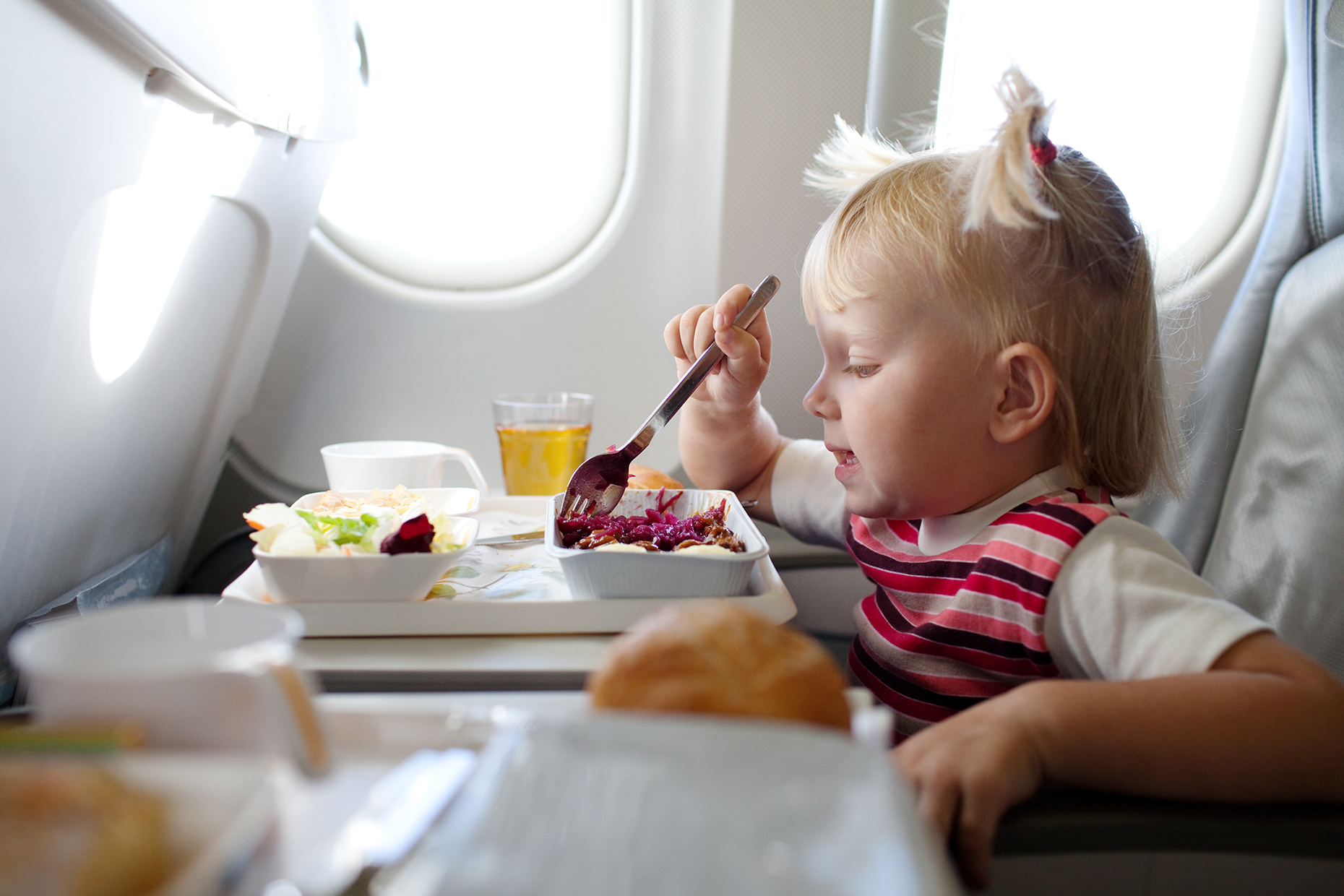 Baby eating plane food