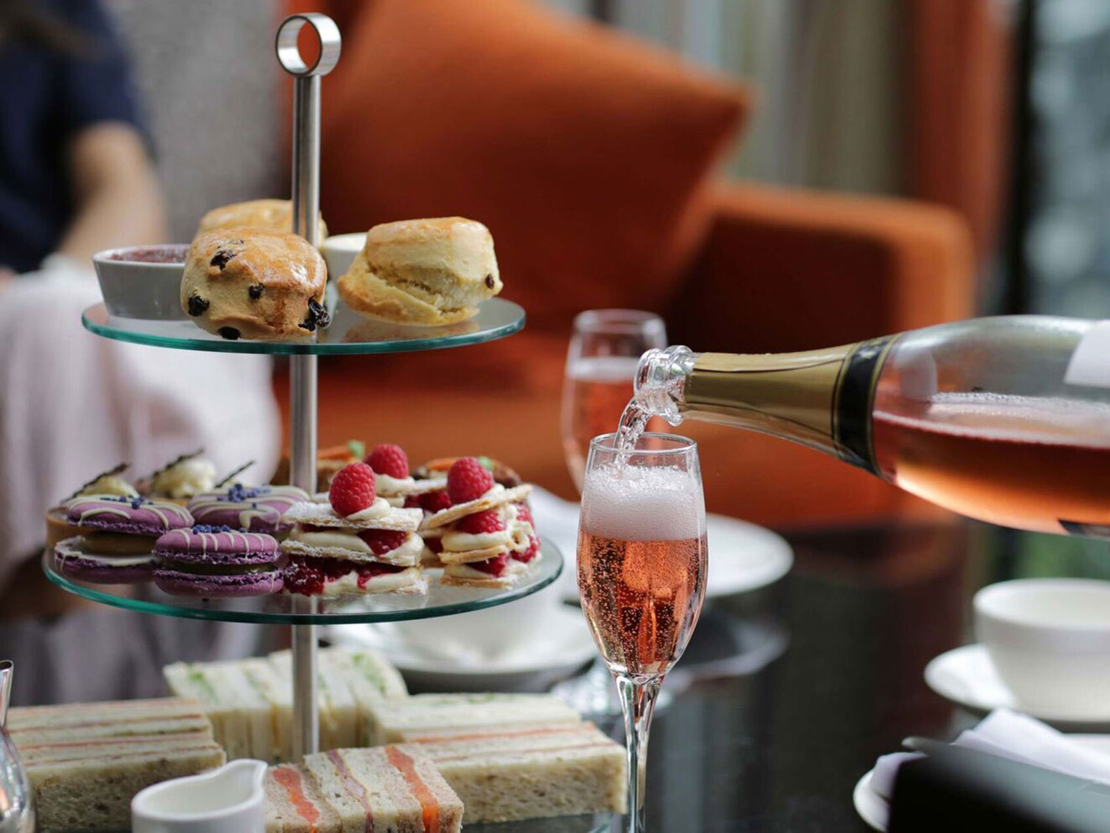 Traditional afternoon tea with glass of pink fizz