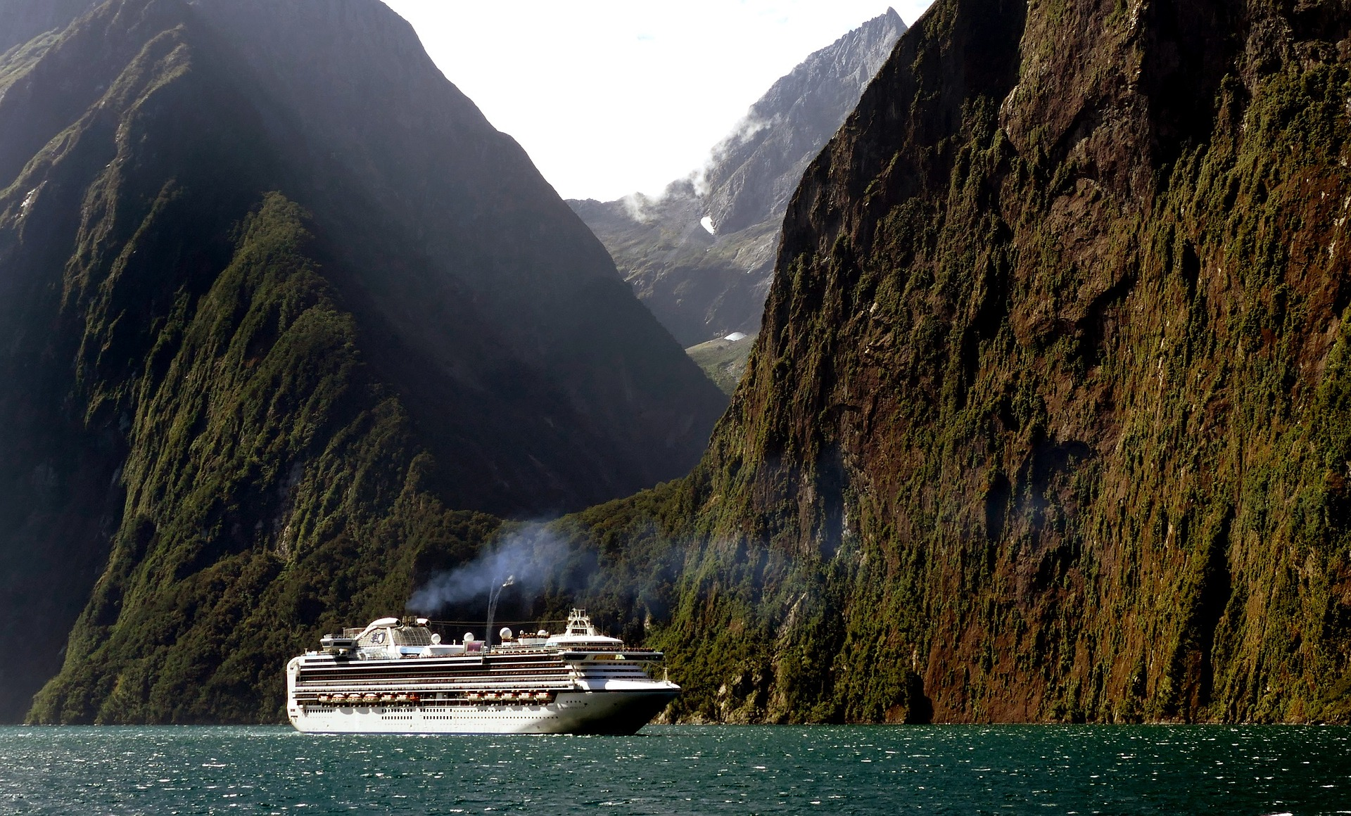 Cruise ship near mountains