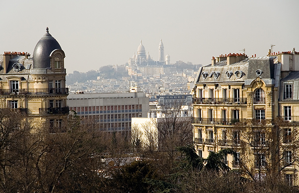 View of the Basilica Sacre-Coeur from the park des Buttes-Chaumont, Paris, France