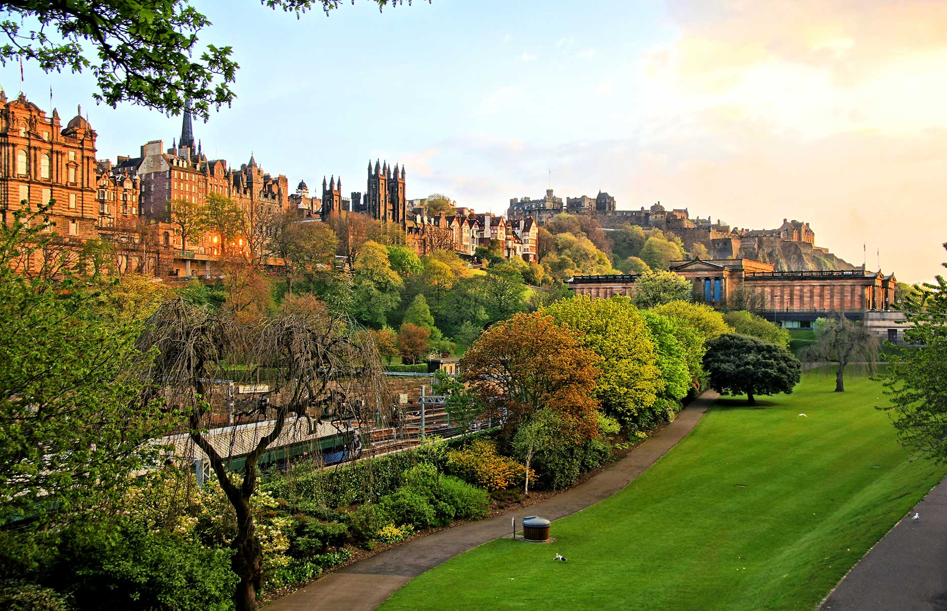 View of Edinburgh at sunset from Princes Street (Image: JeniFoto/Shutterstock)