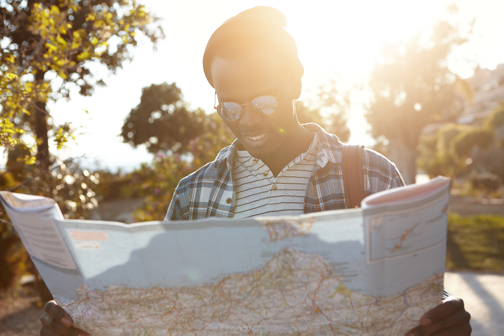 Man reading map travelling alone