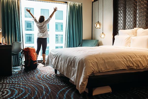 Woman alone hotel room
