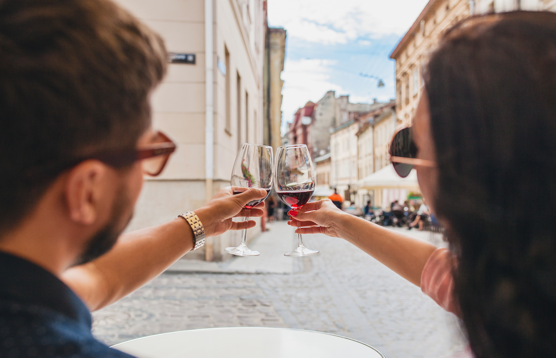 Couple on vacation with wine