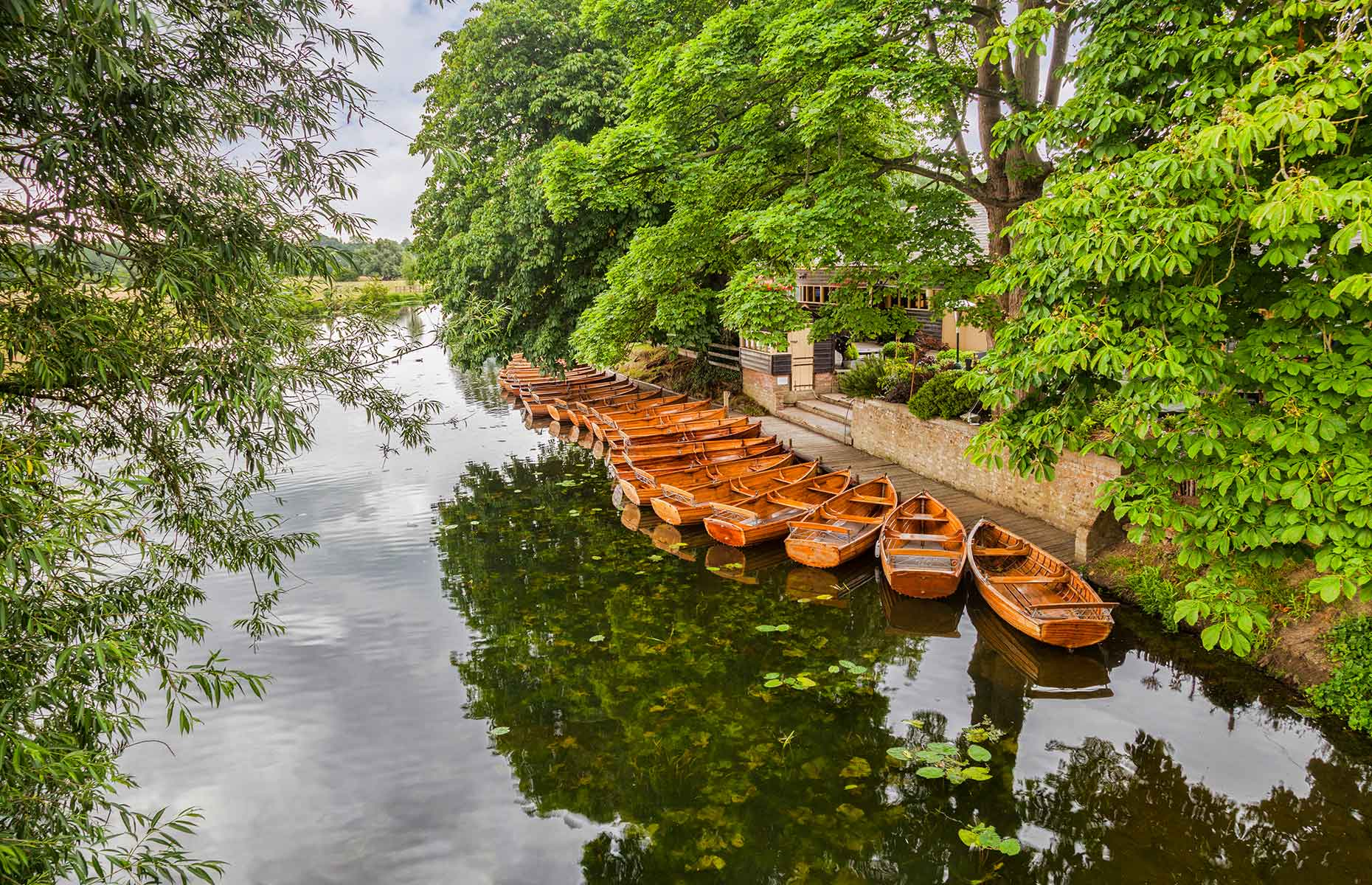Boats on the River Stour in summer at Dedham Essex (Image: travellight/Shutterstock)
