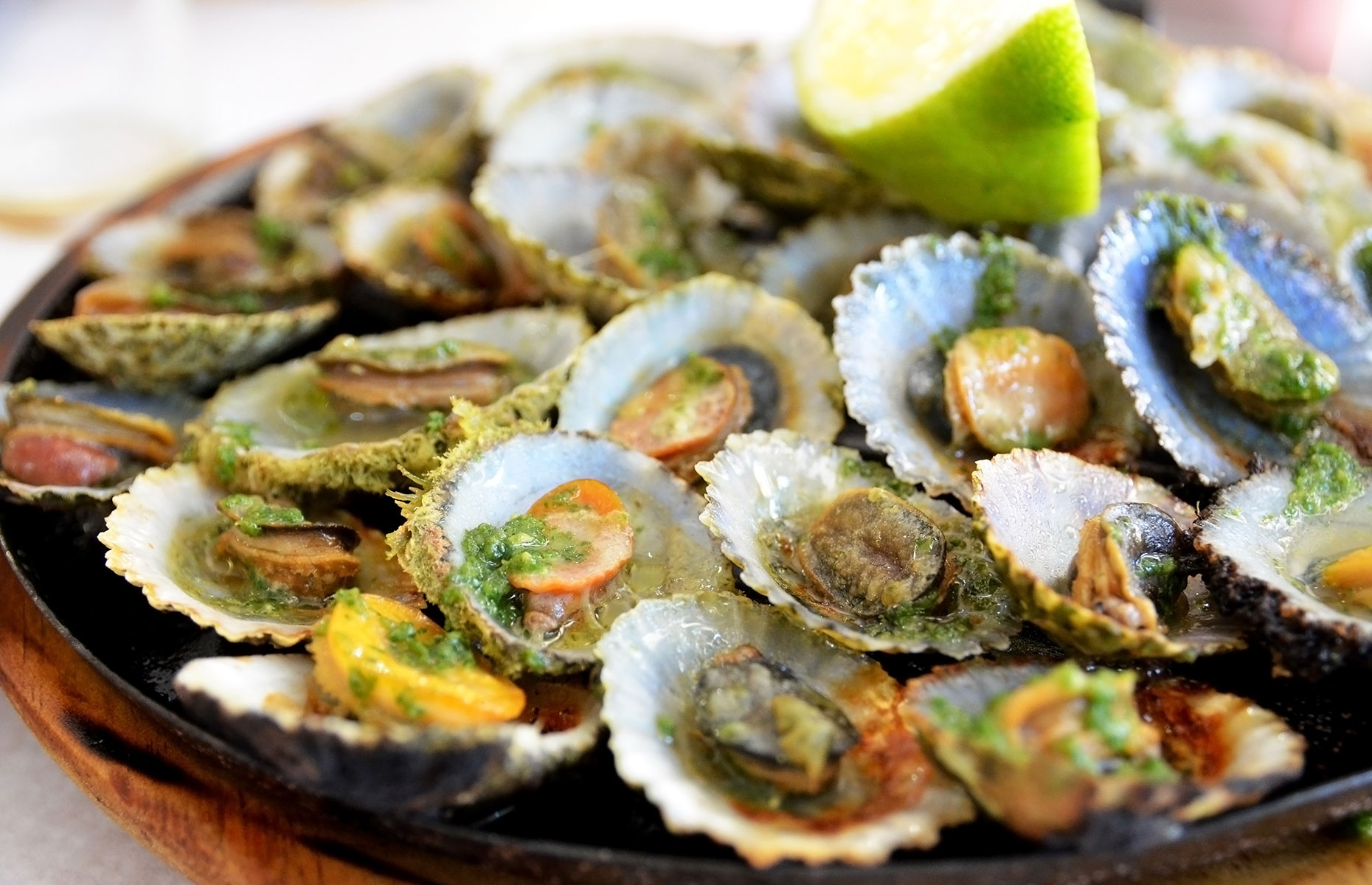 Lapas grelhadas or grilled limpets is a local speciality (Image: svf74/Shutterstock)