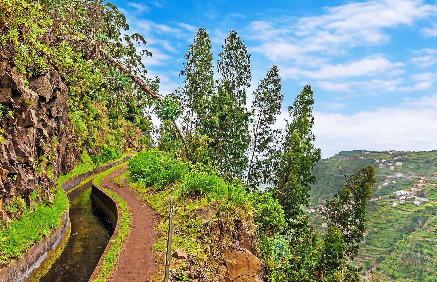 Hiking along irrigation channel (Levada) in Madeira (Image: aldorado/Shutterstock)
