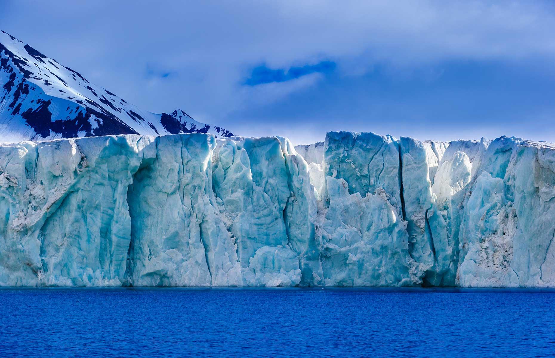 Aqua-coloured glacier, Svalbard (Don Landwehrle/Shutterstock)