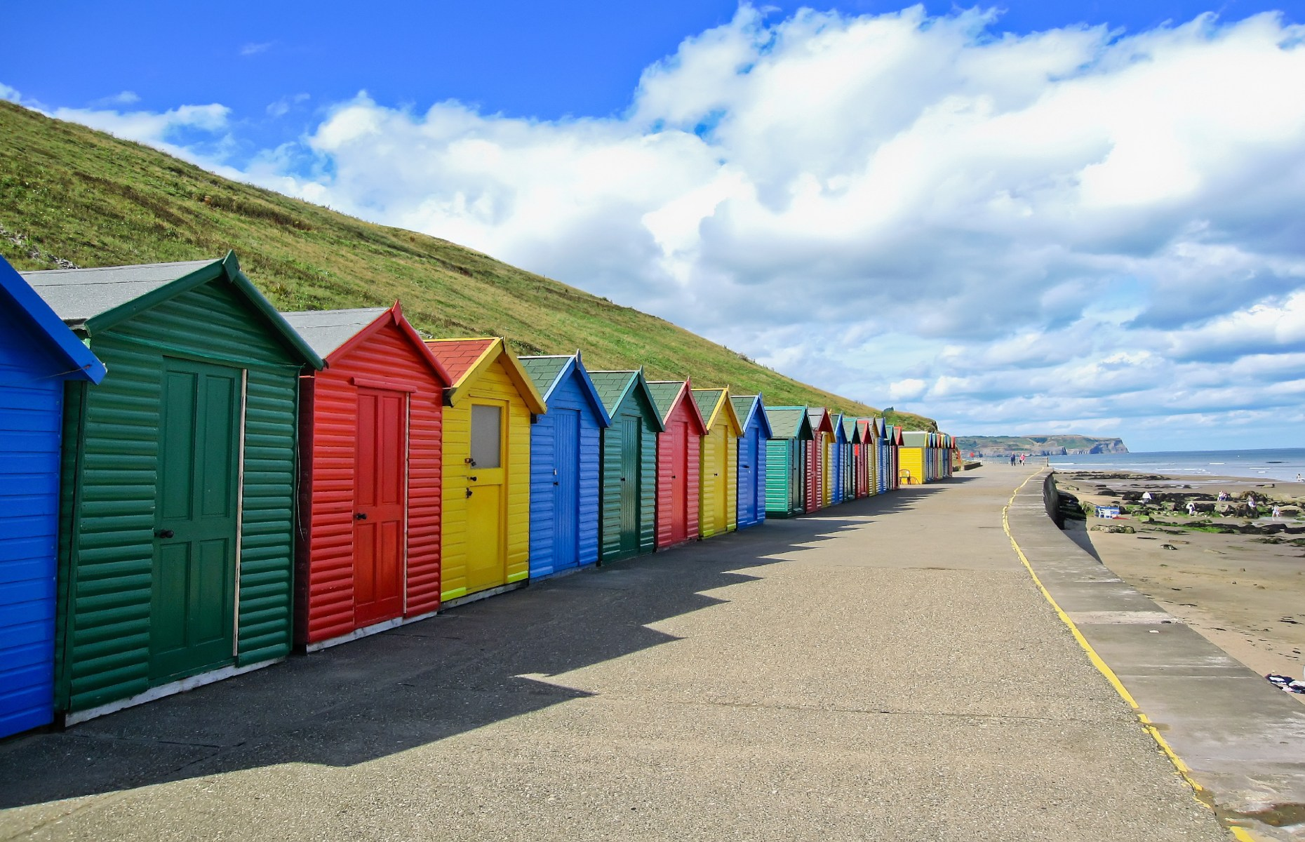 Beach huts on Whitby Sands (Image: Javen/Shutterstock)