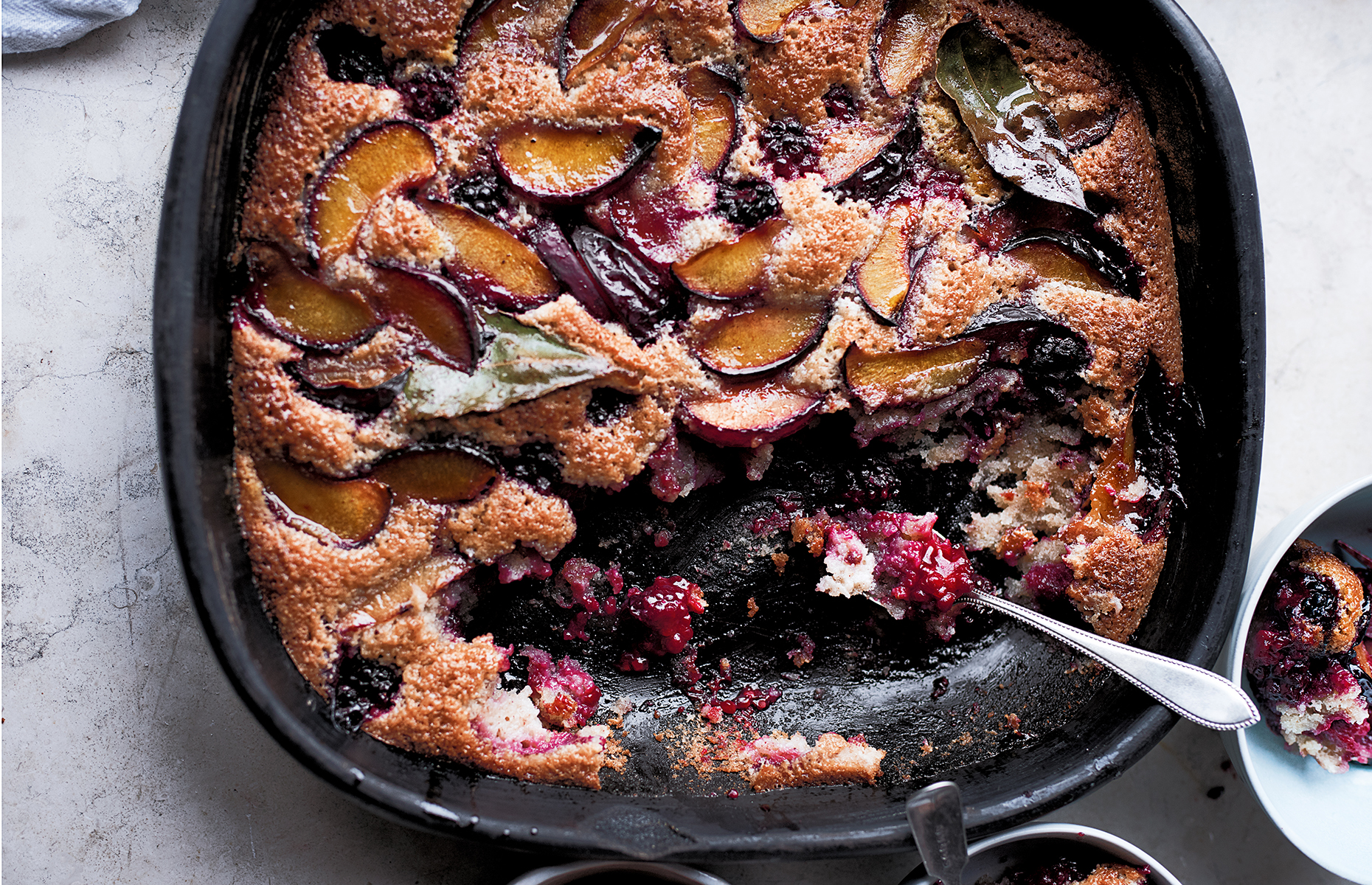Plum, blackberry and bay friand bake
