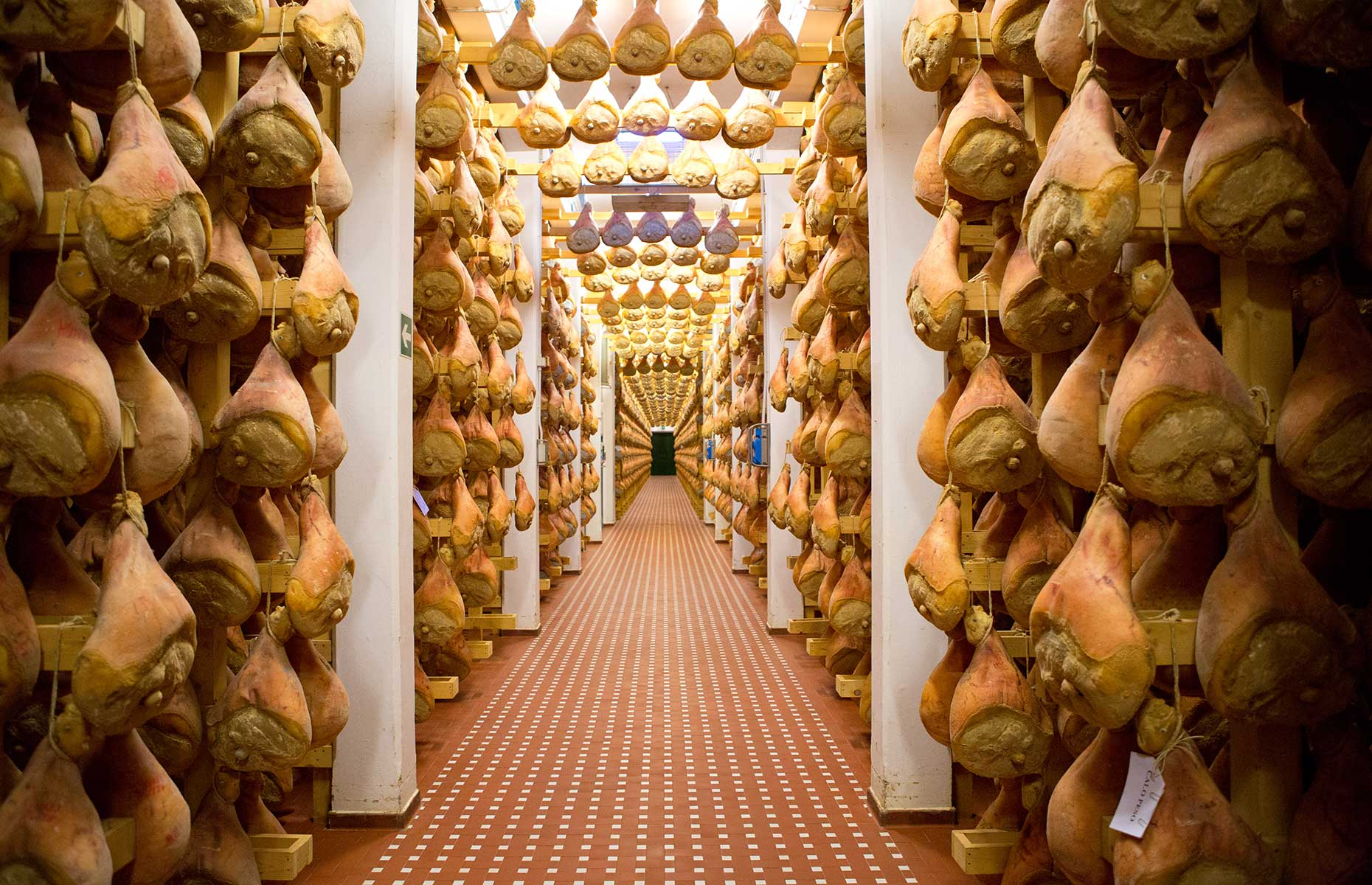 Hanging legs of Parma Ham (Image courtesy of Consorzio del Prosciutto di Parma)