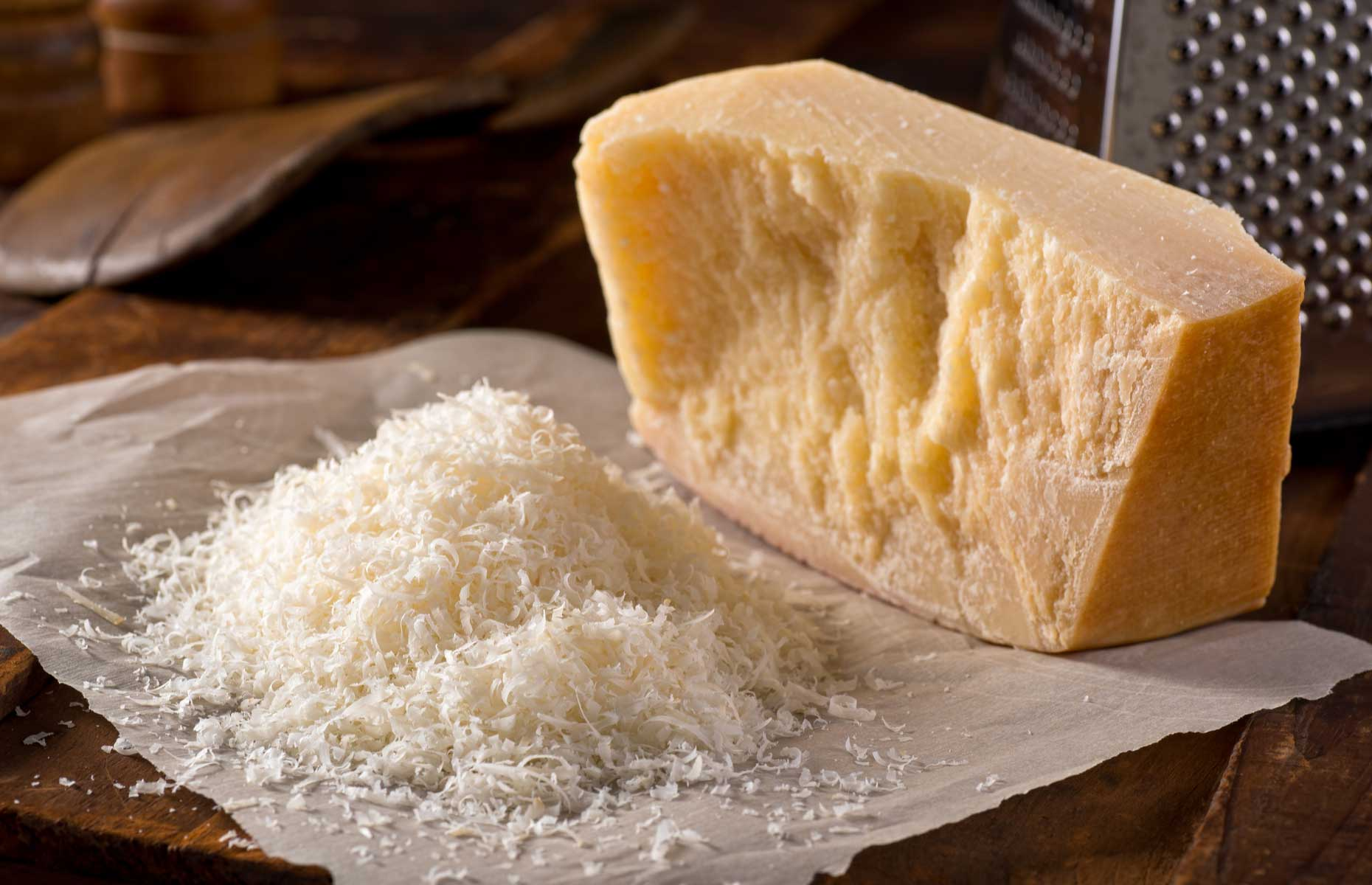 Grated and block of parmesan (Image: Foodio/Shutterstock)