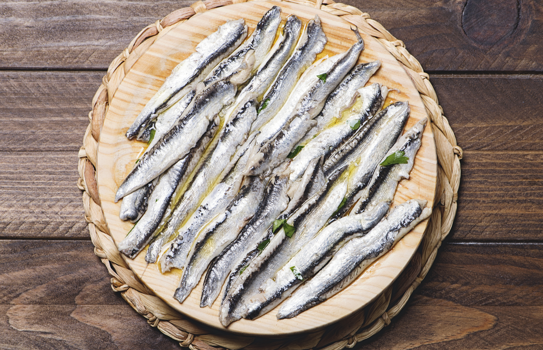 Marinated anchovies on a board (Image: Lleistock/Shutterstock)