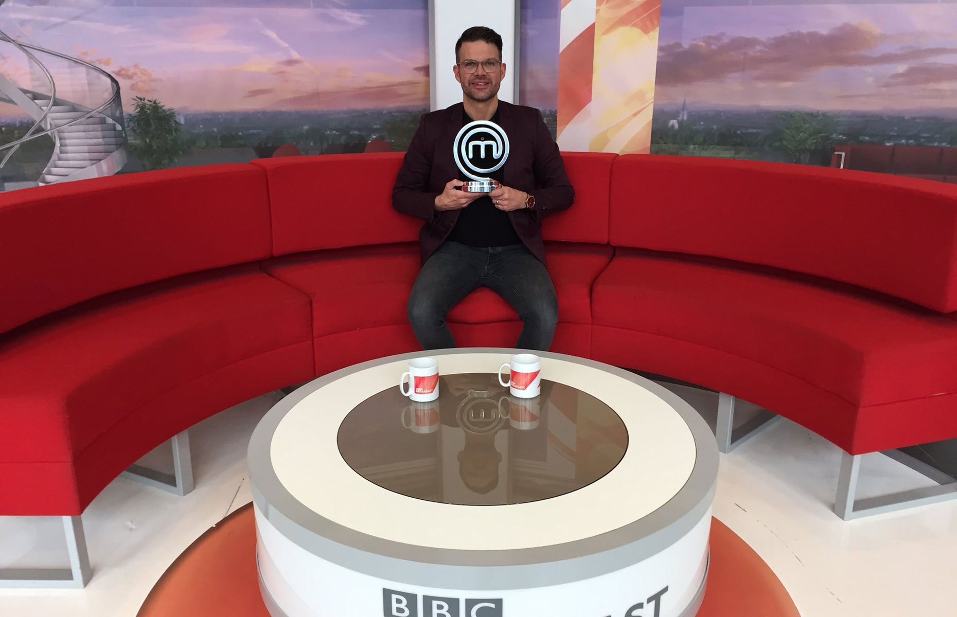 Kenny Tutt previous MasterChef winner from 2018 pictured on BBC Breakfast with his winner's trophy (Image: Kenny Tutt/Twitter)
