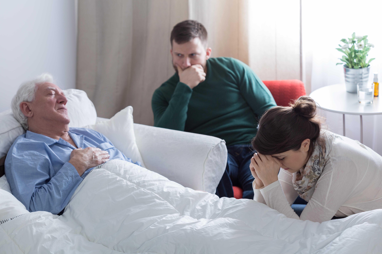 Children gathered around sick dad bedside (Shutterstock)