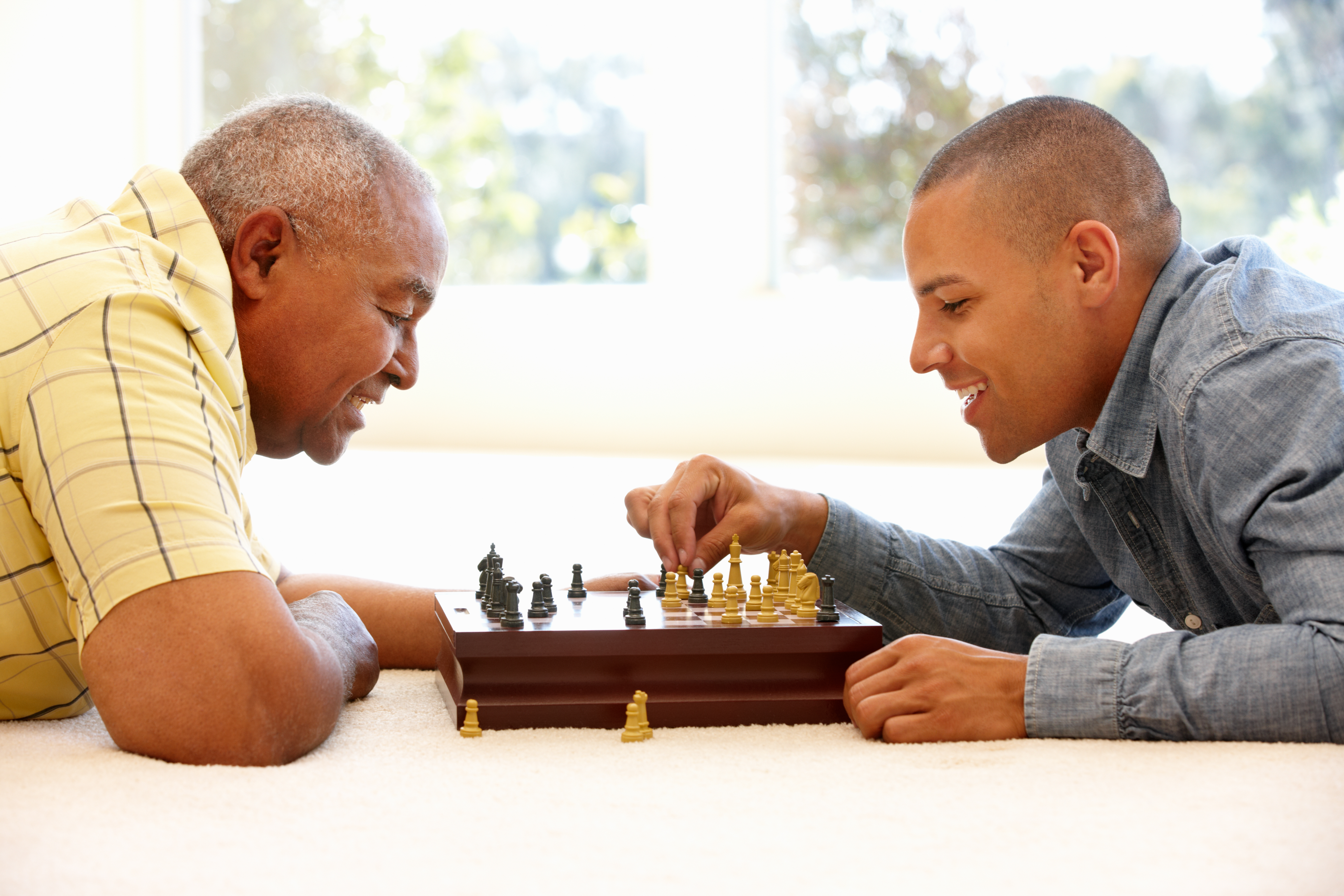 Father and son having a conversation over game (Shutterstock)