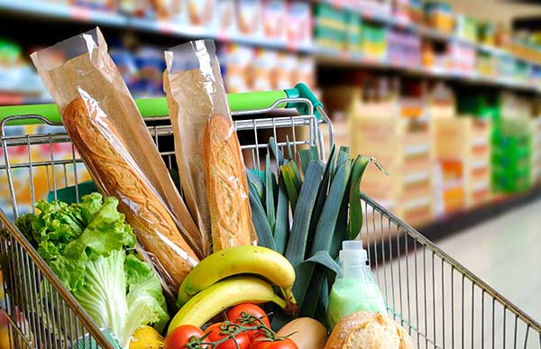Groceries in a supermarket trolley. (Image: Shutterstock)