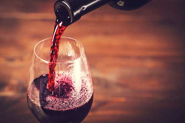 Wine poured into a glass. (Image: Shutterstock)
