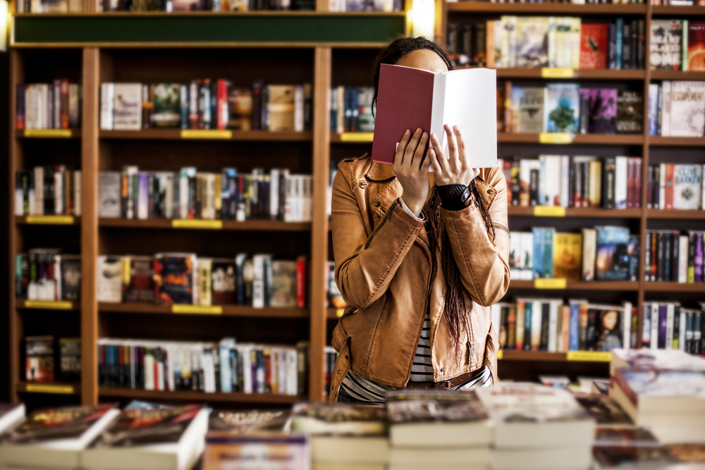Woman reading book. (Image: Shutterstock)