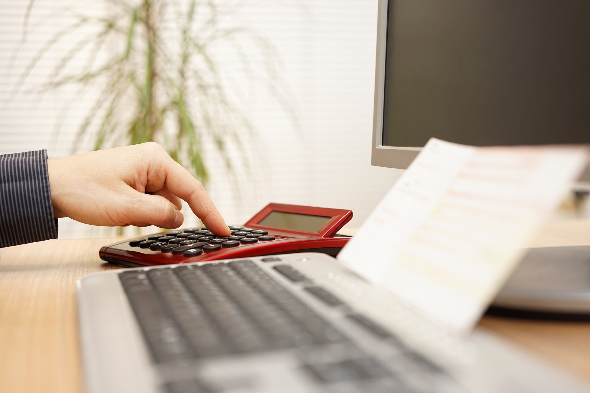 Man calculating monthly payments. (Image: Shutterstock)