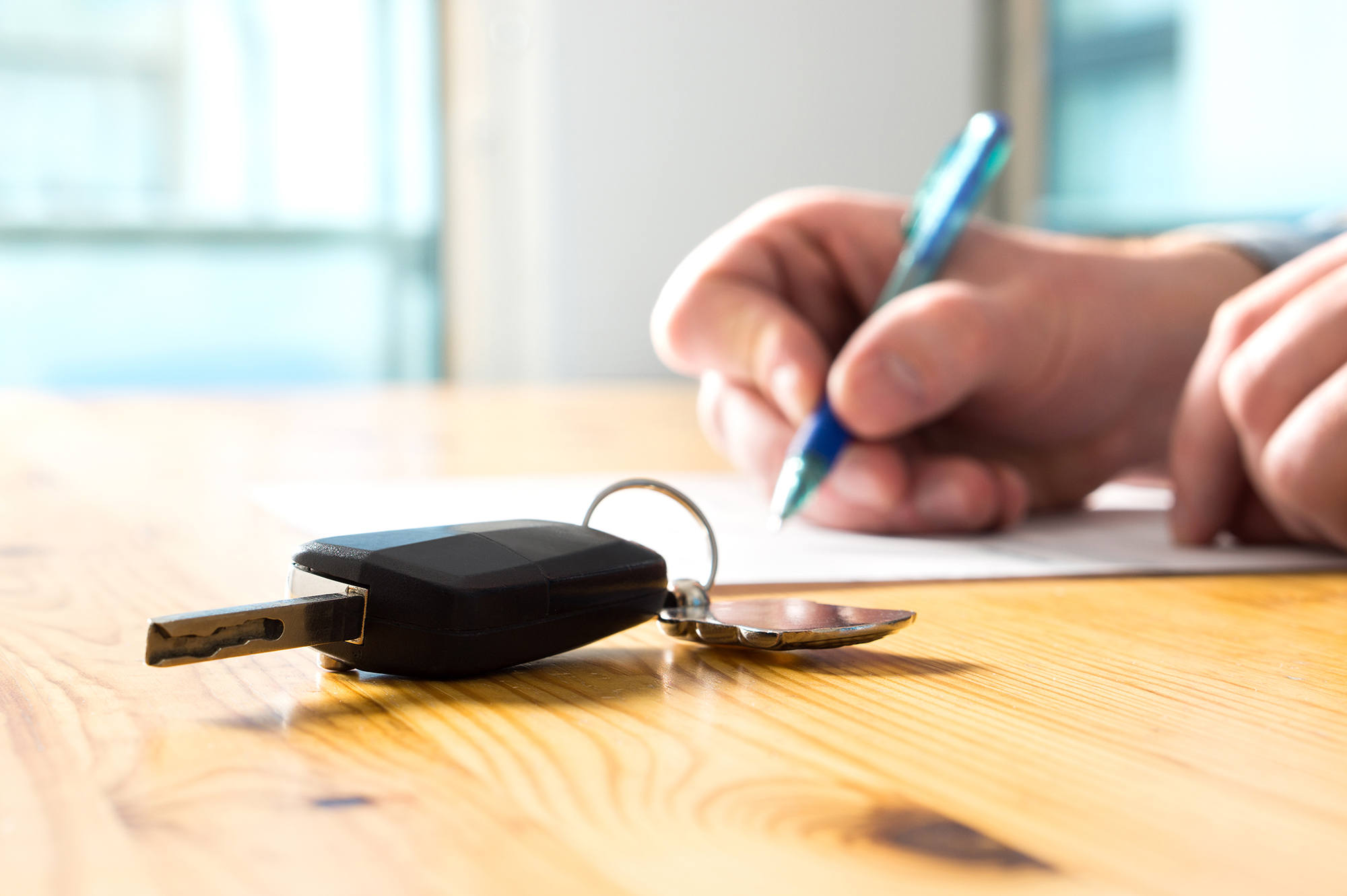 Man signing a contract. (Image: Shutterstock)