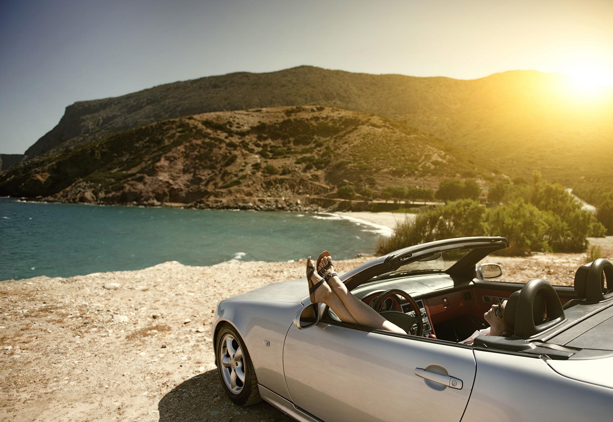 Woman relaxing in a luxury car. (Image: Shutterstock)