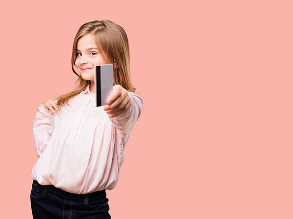 Child with a bank card. (Image: Shutterstock)