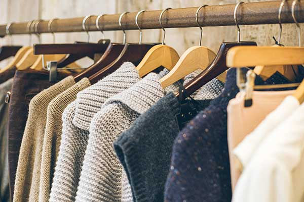 Clothes on a clothes rack. (Image: Shutterstock)