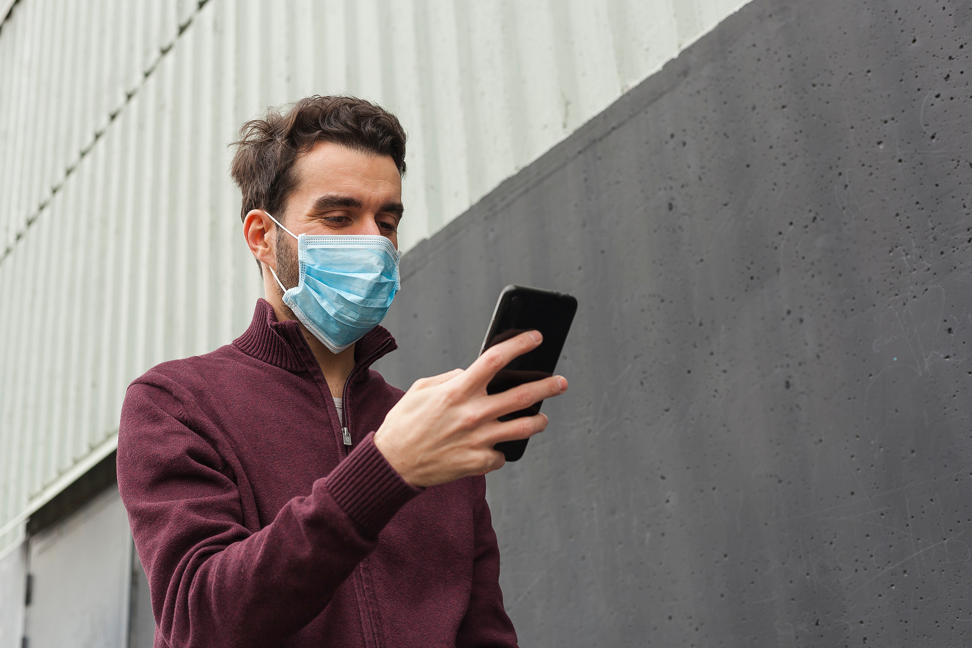 Man wearing a surgical mask. (Image: Shutterstock)