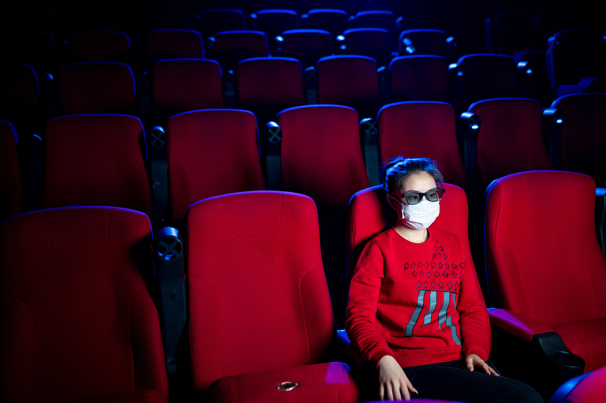 Woman at a cinema. (Image: Shutterstock)