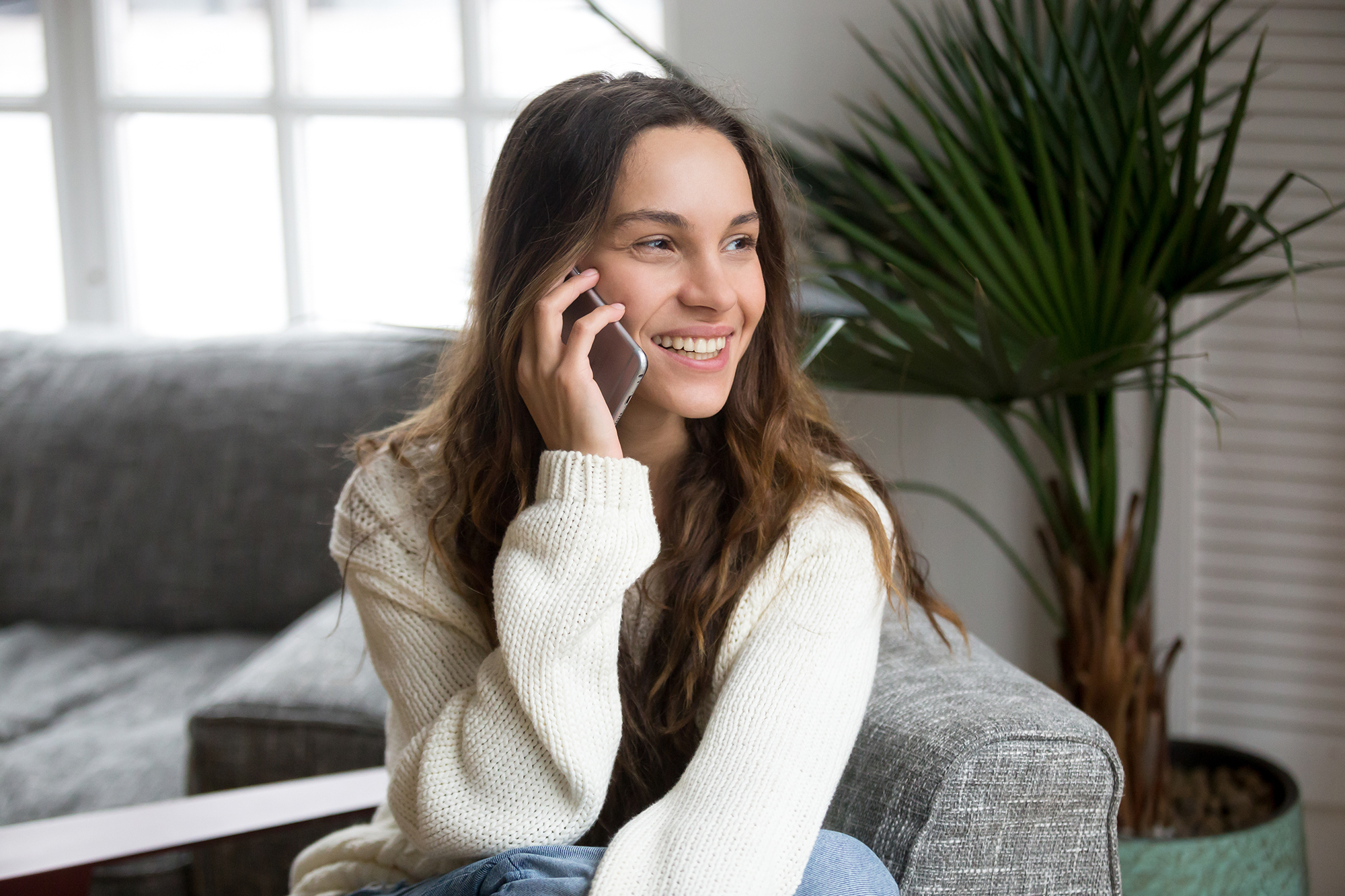 Happy woman on the phone. (Image: Shutterstock)