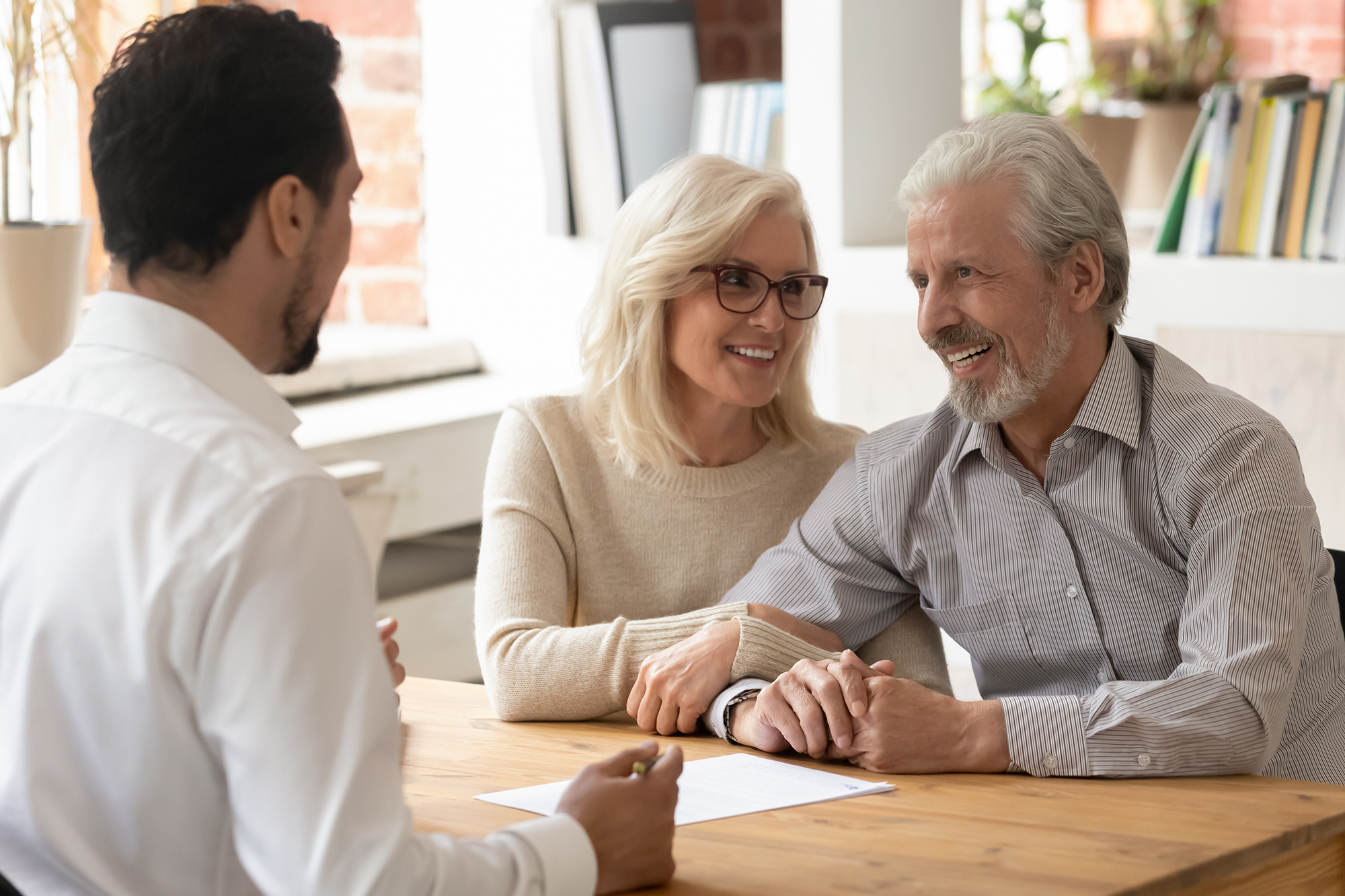 Older couple getting financial advice. (Image: Shutterstock)
