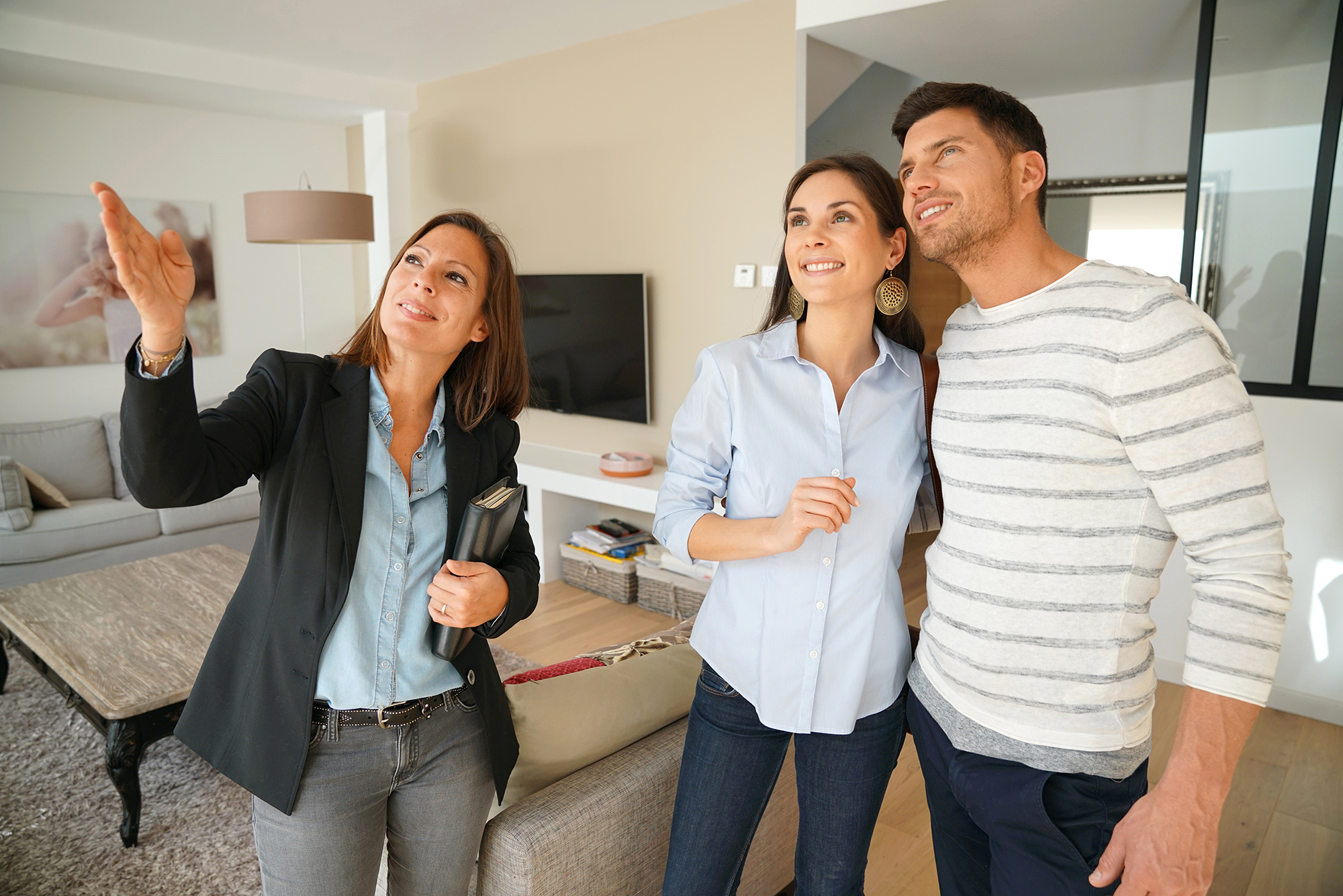 Estate agent showing a couple a house. (Image: Shutterstock)