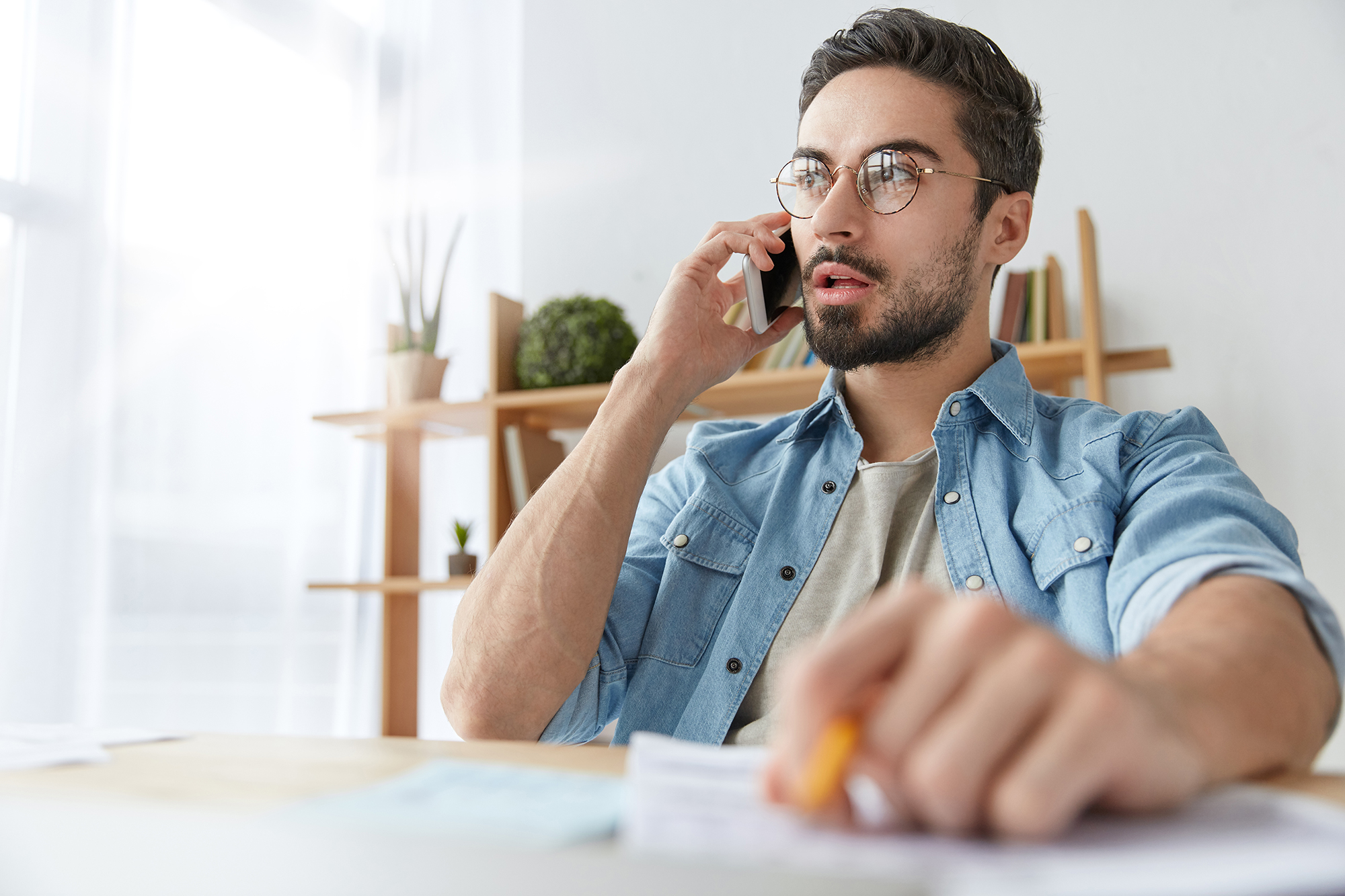 Man talking to someone on the phone. (Image: Shutterstock)