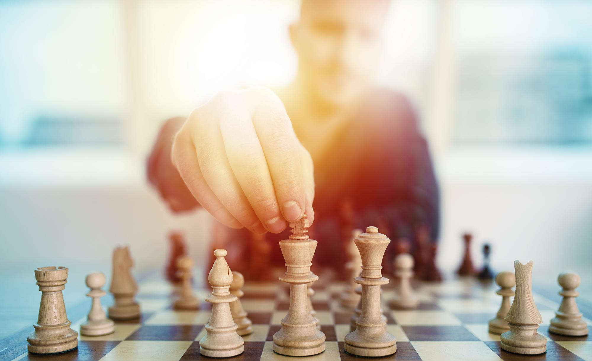 Man playing chess. (Image: Shutterstock)