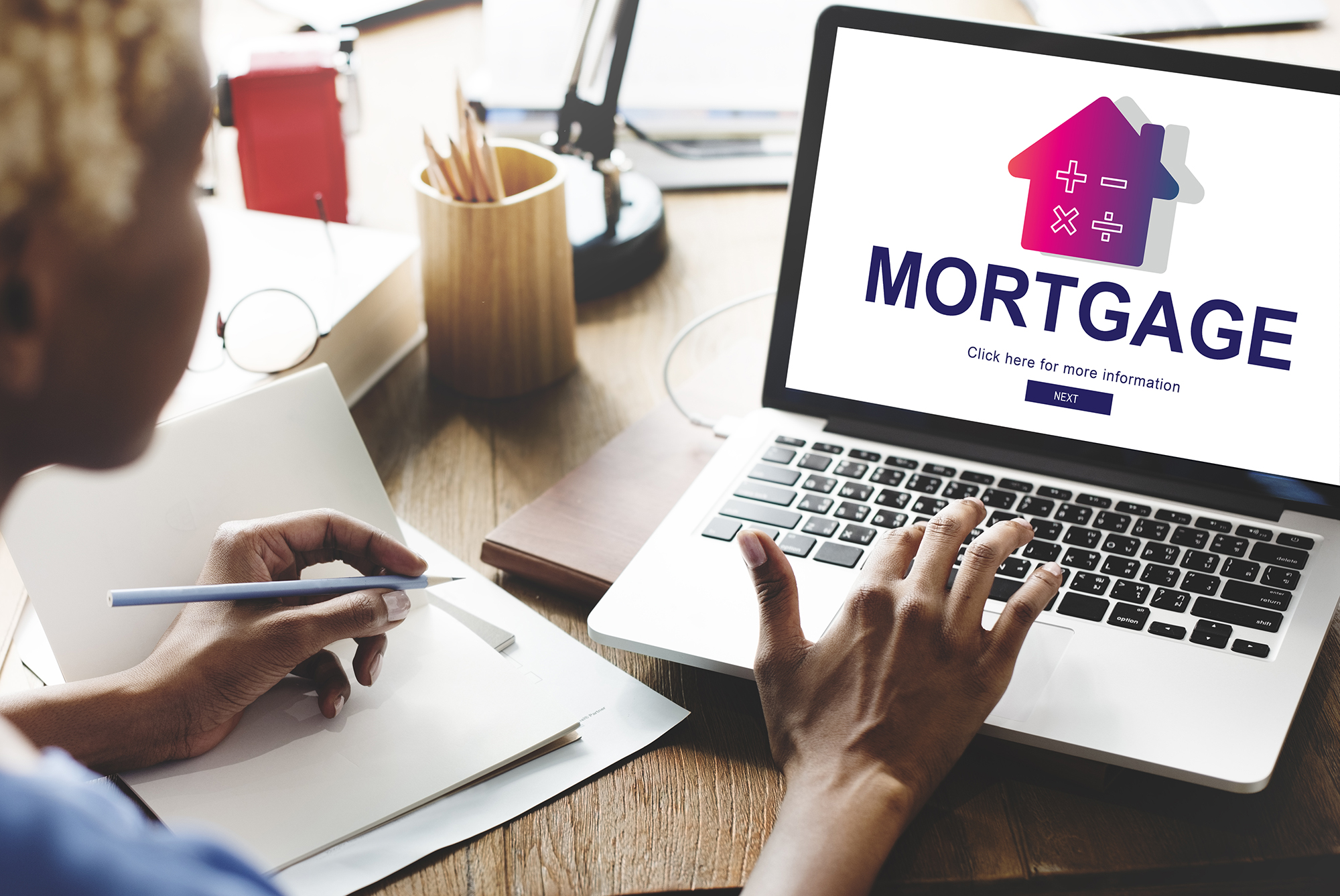 Woman looking up mortgage information online. (Image: Shutterstock)