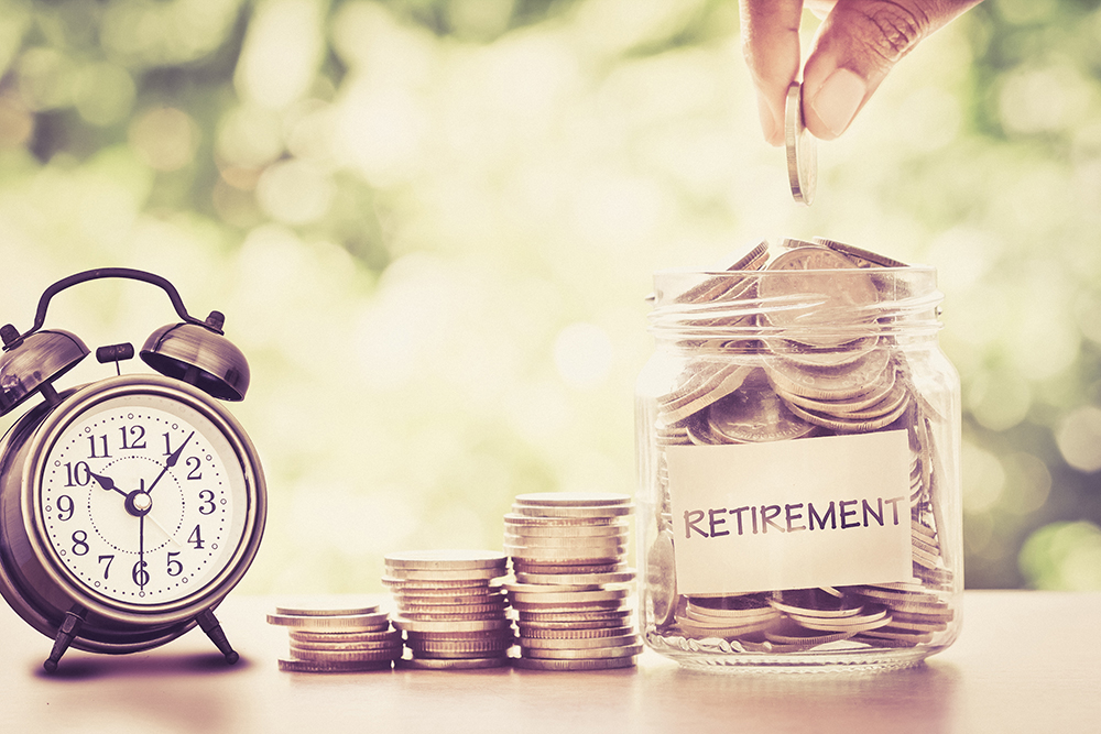 A pot for retirement filled with coins next to a clock. (Image: Shutterstock)