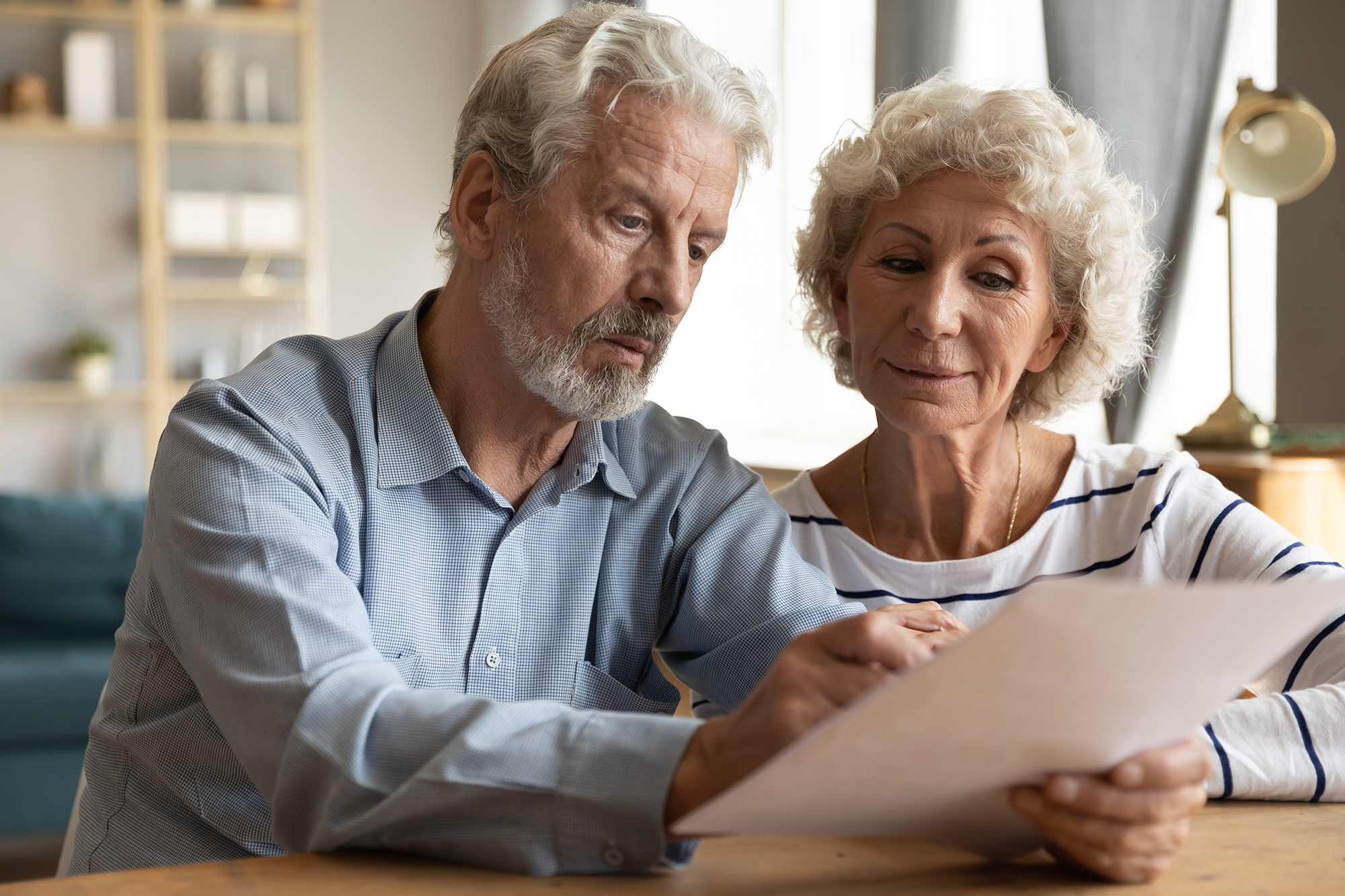 Older couple checking pension statement. (Image: Shutterstock)
