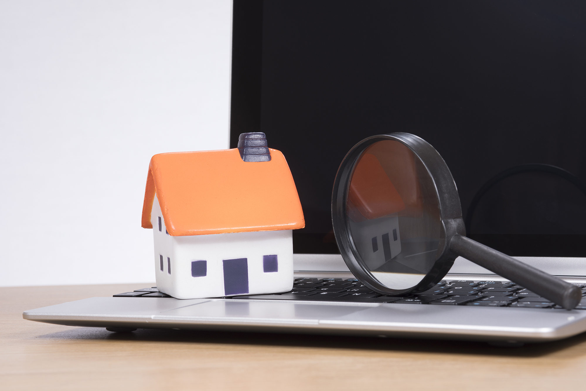 Tiny house model on top of laptop. (Image: Shutterstock)