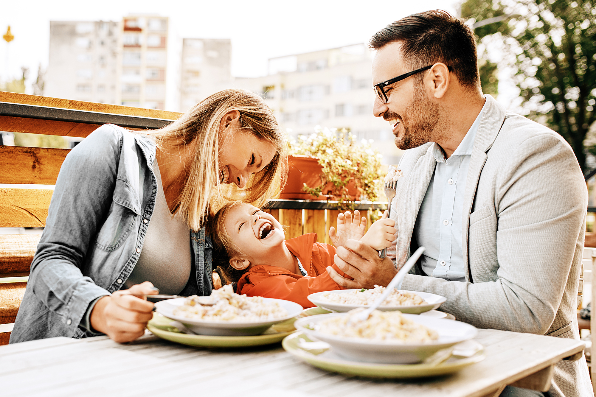 Happy family eating at a restaurant. (Image: Shutterstock)