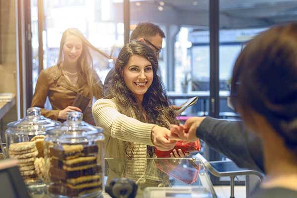 Woman using a reward credit card. (Image: Shutterstock)