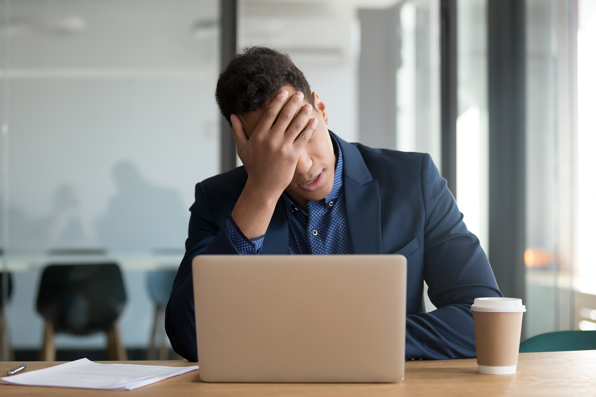 An upset man in a smart suit. (Image: Shutterstock)