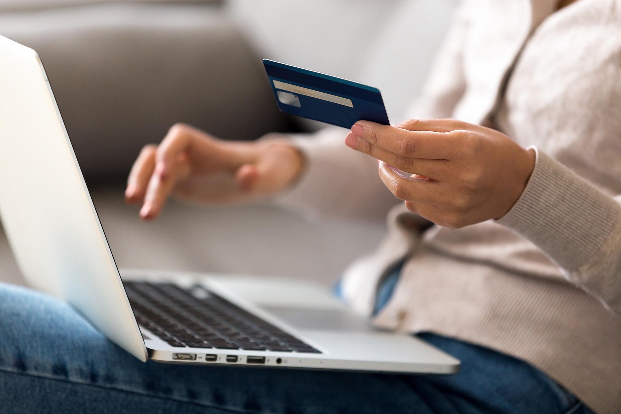 Woman using bank card. (Image: Shutterstock)