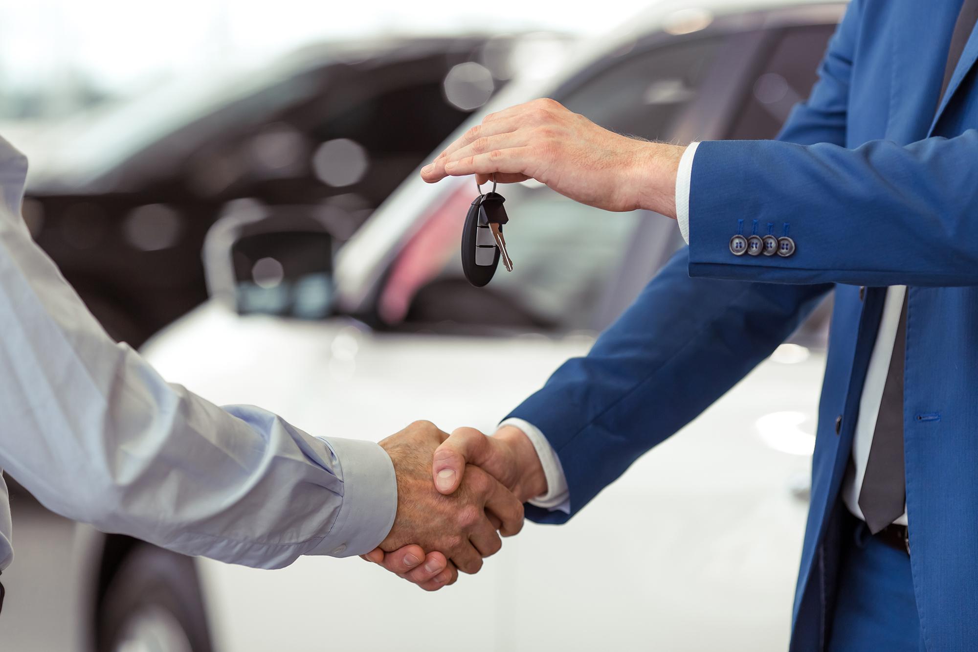 Two men shaking hands. (Image: Shutterstock)